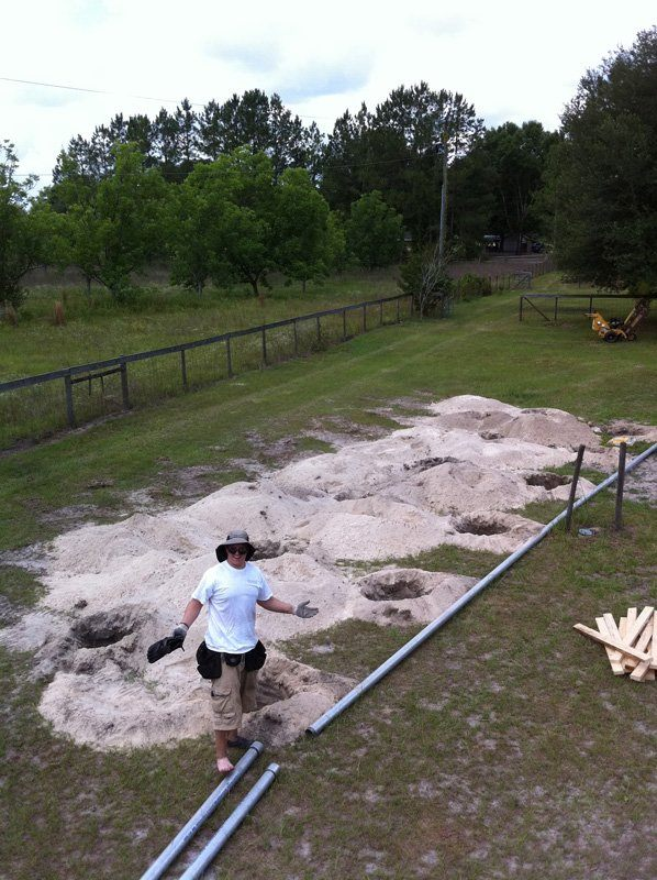Footers dug to prepare the site for a ground mount solar installation in Fort White, FL