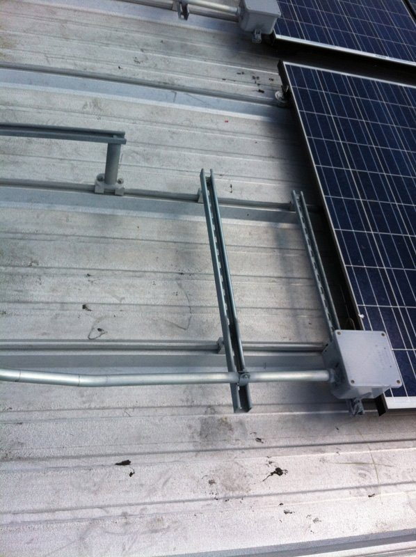 Electrical installation on a metal roof of a commercial building in Orlando, FL
