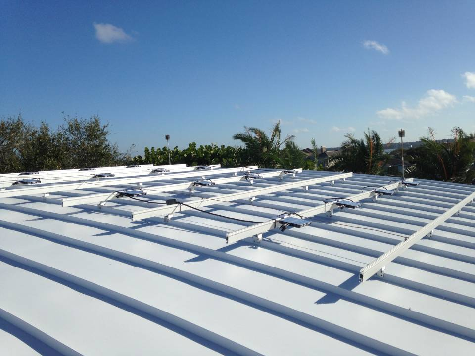 Solar racks and Micro Inverters installed on a metal roof