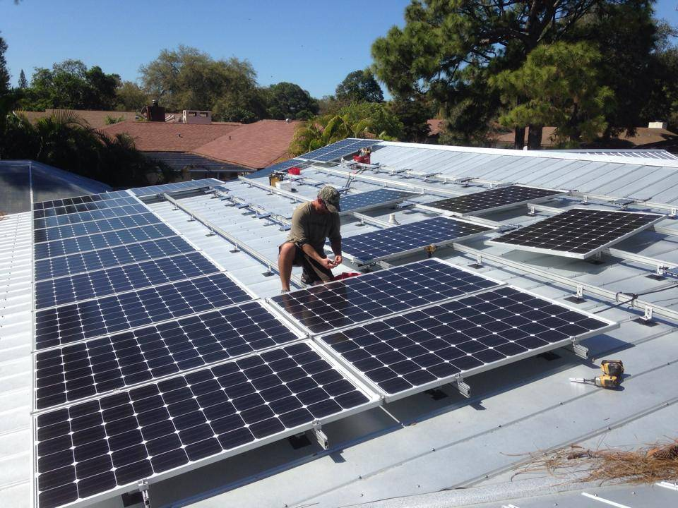 Solar Panels being installed on a metal roof