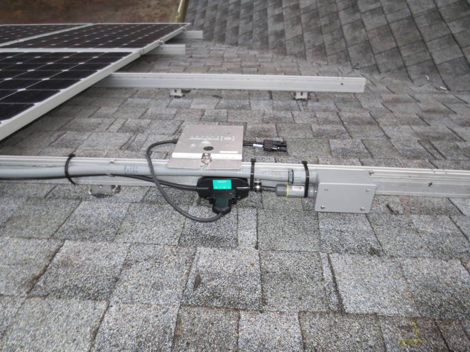 Wiring the Array on a shingle roof in Northport, FL