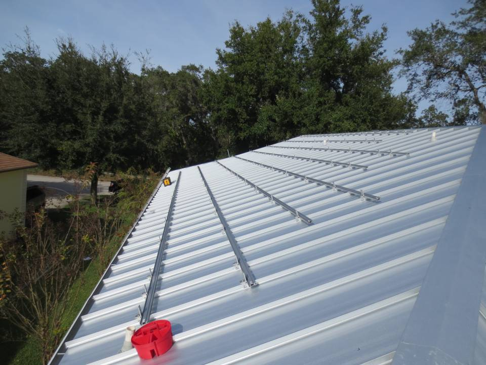 Solar Roof Rails being installed on the roof