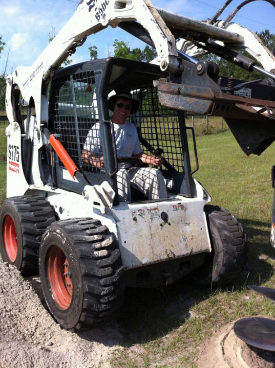 Bobcat brought in to prepare the site for a ground mount solar installation in Fort White, FL