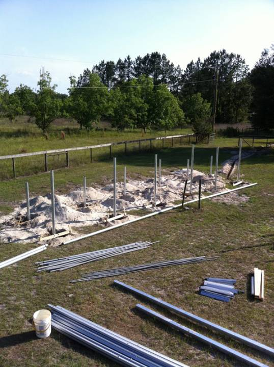 Getting the footers ready for concrete to prepare the site for a ground mount solar installation in Fort White, FL