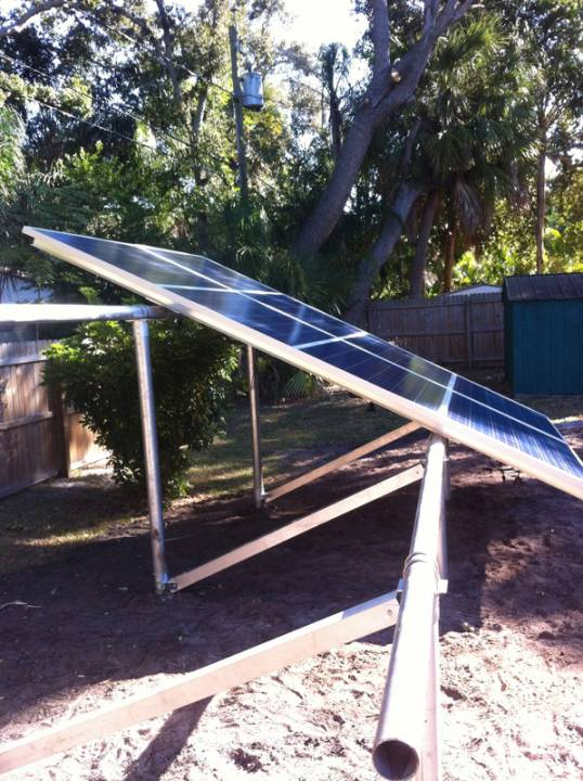 Installing the solar panels on a ground mount in St. Pete, FL
