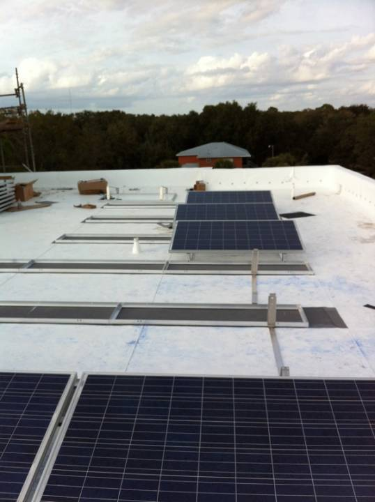 Solar panel installation on commercial building in Tampa, FL
