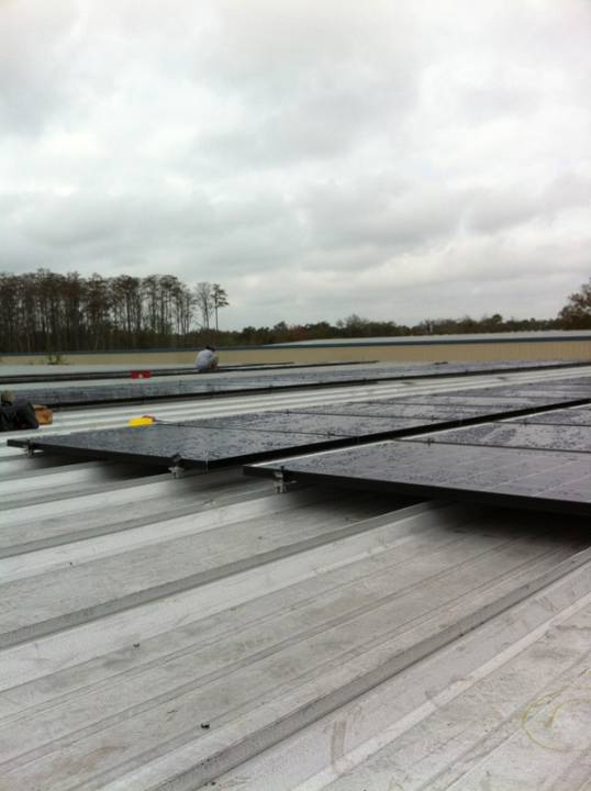 Solar Panel installation on a metal roof of a commercial building in Orlando, FL