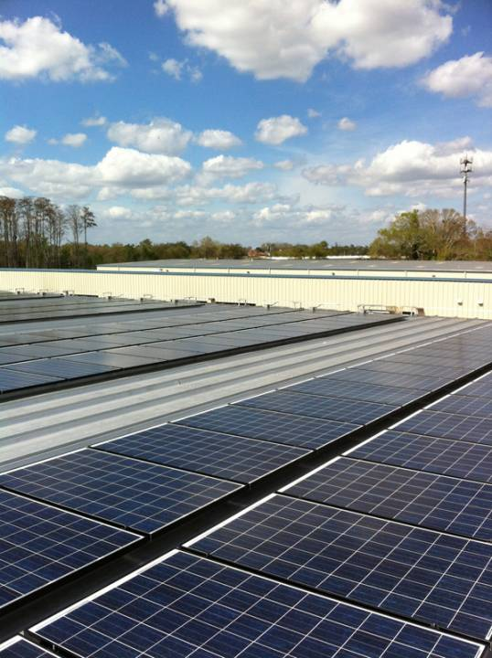 Roof view of Solar arrays on a metal roof of a commercial building in Orlando, FL