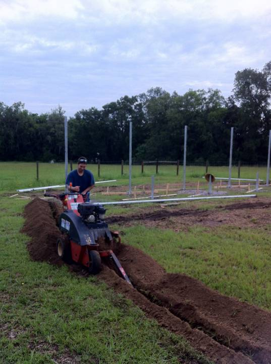 Digging the ditch to lay conduit for wiring the solar system in Micanopy, FL