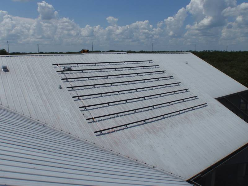 Solar racks being installed on a metal roof in Auburndale, FL