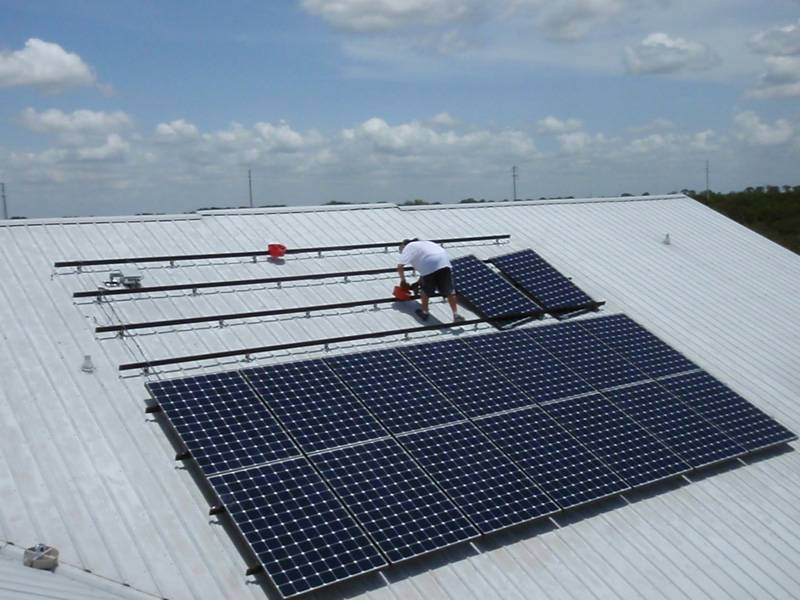 Solar panels being installed on a metal roof in Auburndale, FL