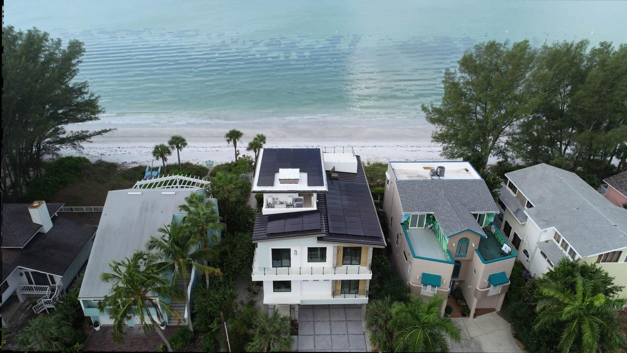 Overhead view of a solar installation on a metal roof in Treasure Island, FL