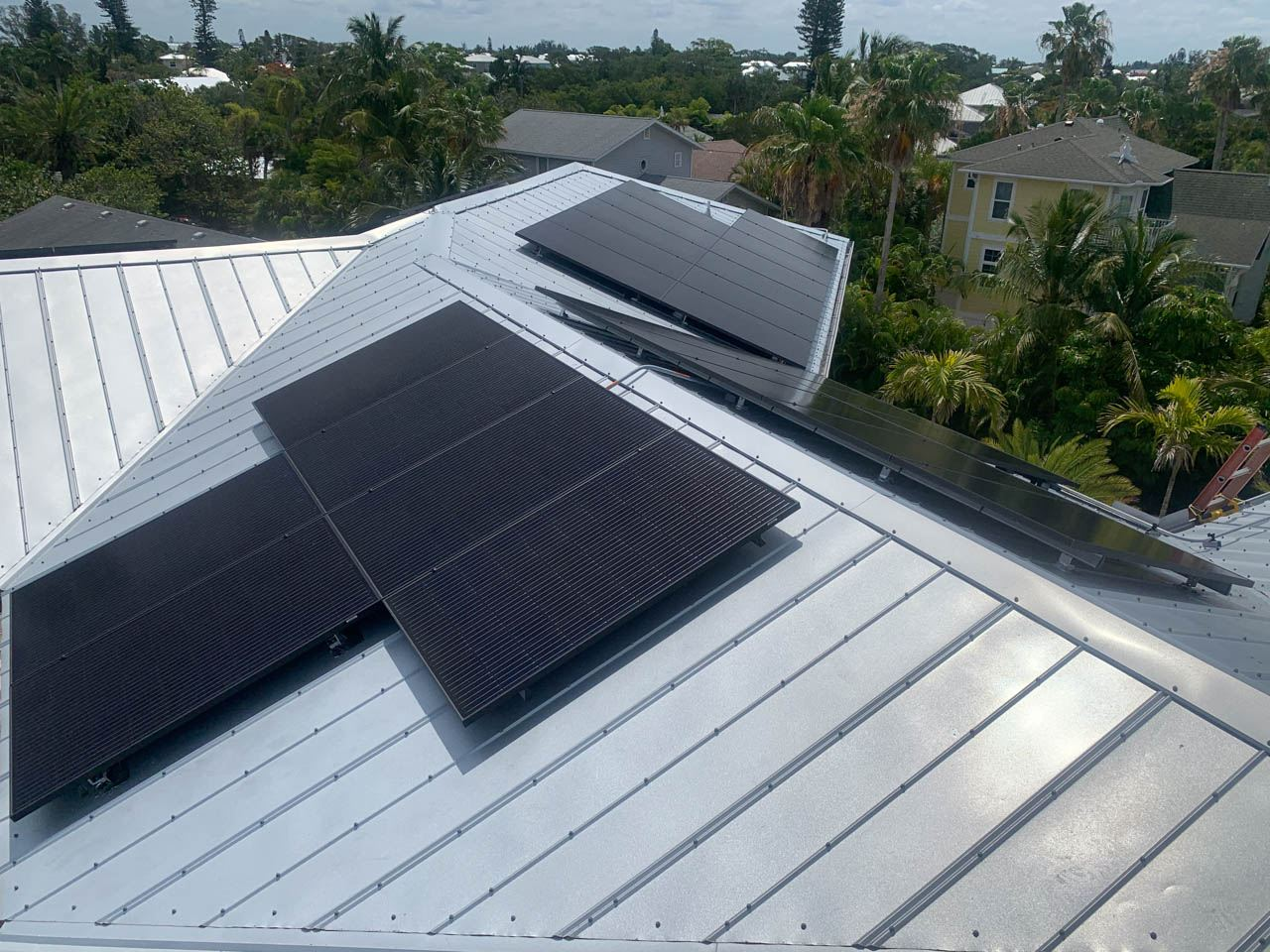 Solary array of a solar installation on a metal roof in Holmes Beach, FL