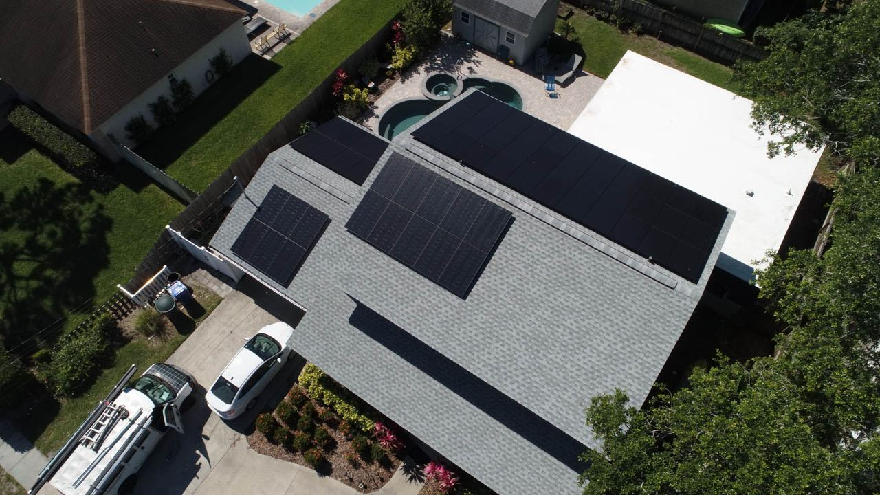 Aerial view of a solar installation on a shingle roof in Dunedin, FL