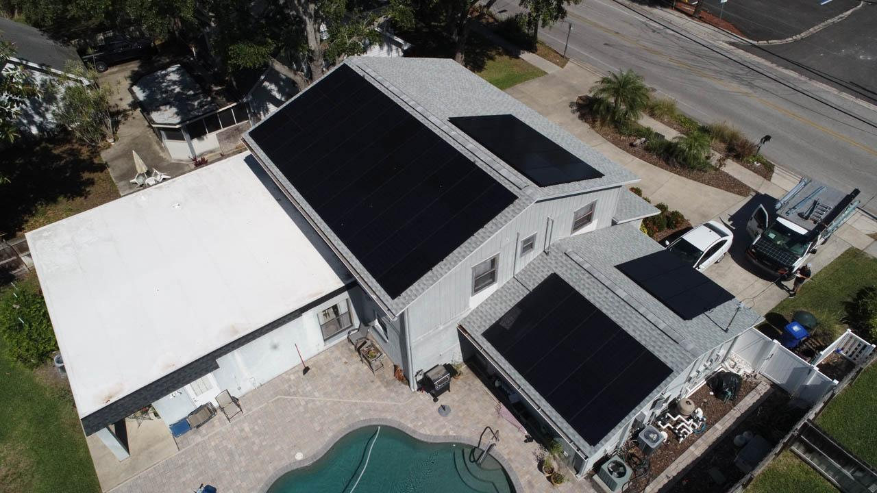 Drone view of a solar installation on a shingle roof in Dunedin, FL