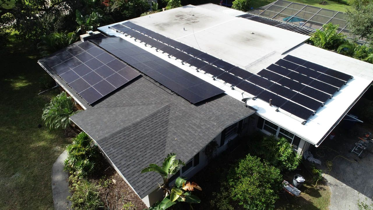 Aerial view of a solar installation on a shingle roof in Clearwater,FL