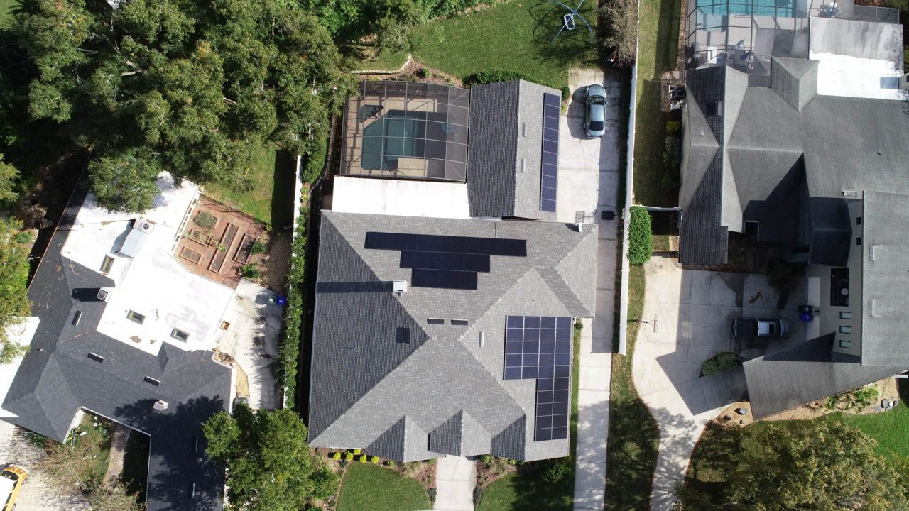 Overhead view of a solar installation on a shingle roof in Lakeland, FL
