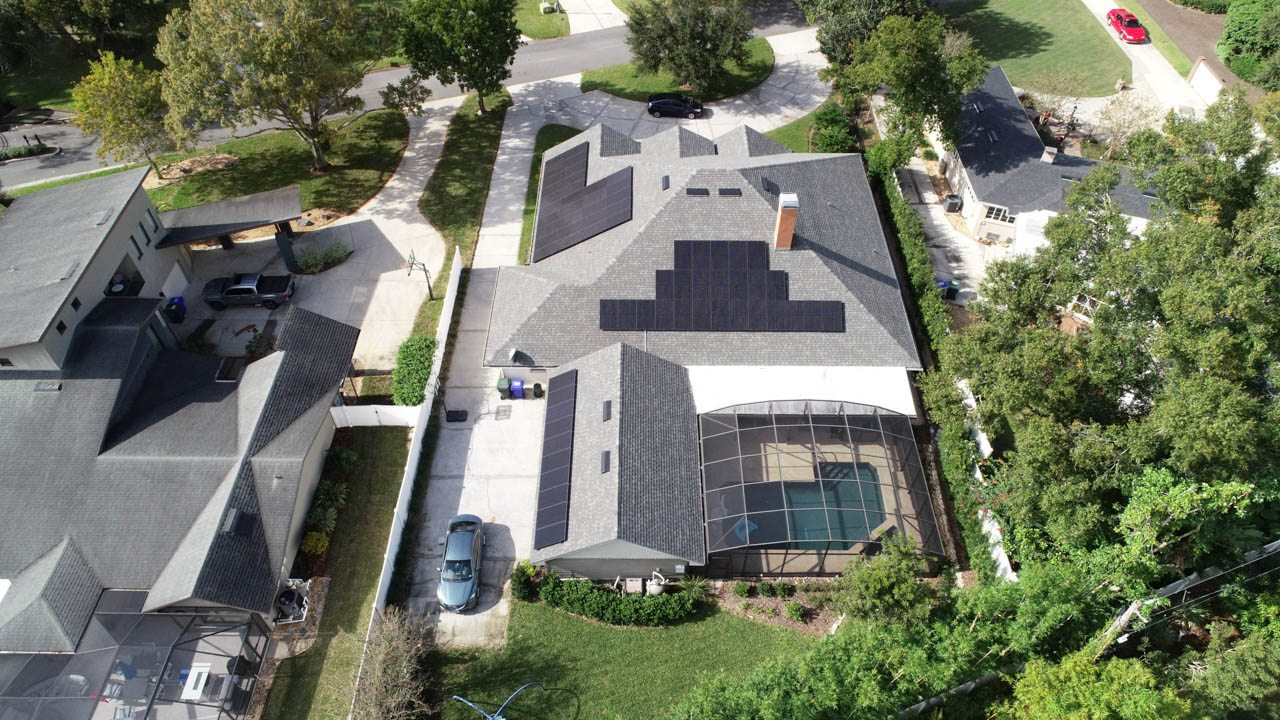 Drone view of a solar installation on a shingle roof in Lakeland, FL