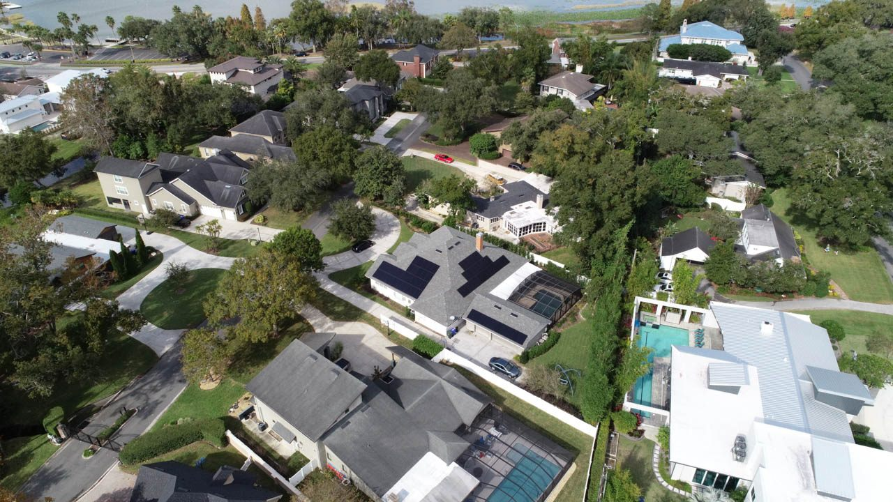 Aerial view of a solar installation on a shingle roof in Lakeland, FL
