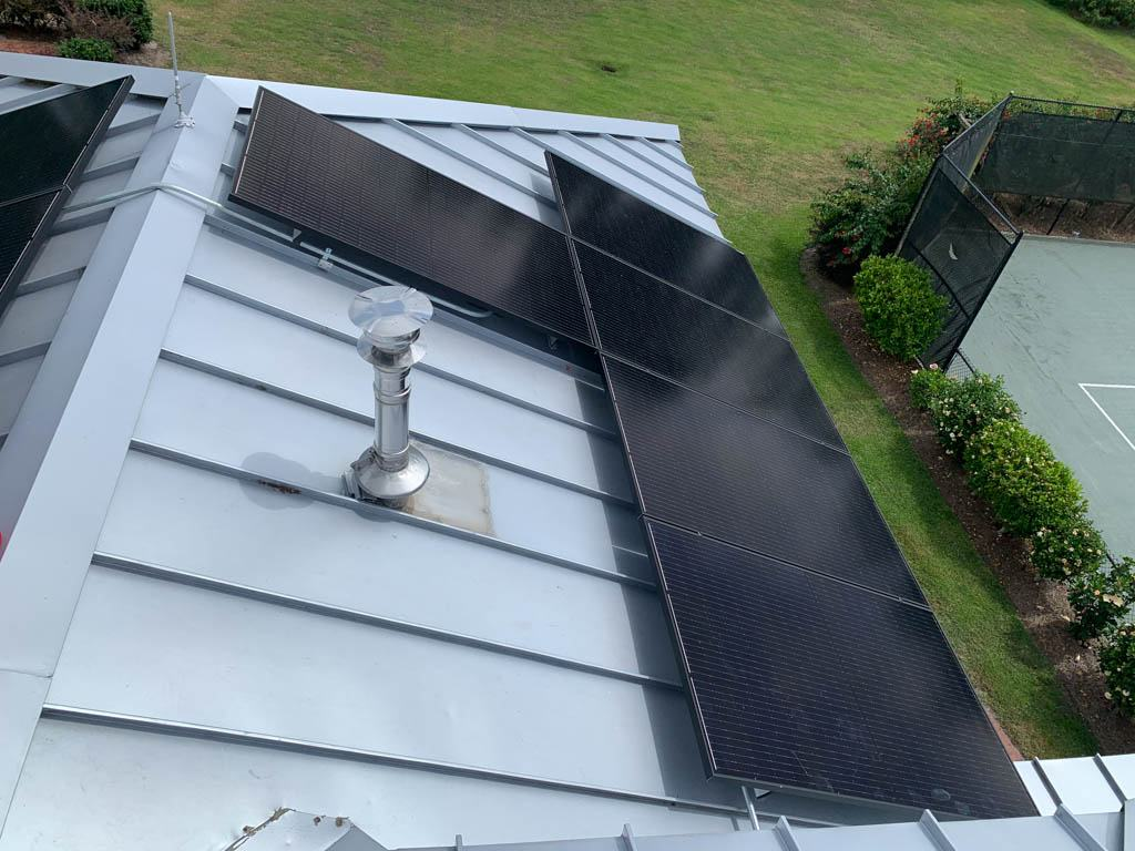 Roof view of a solar array on a metal roof in WInter Haven, FL