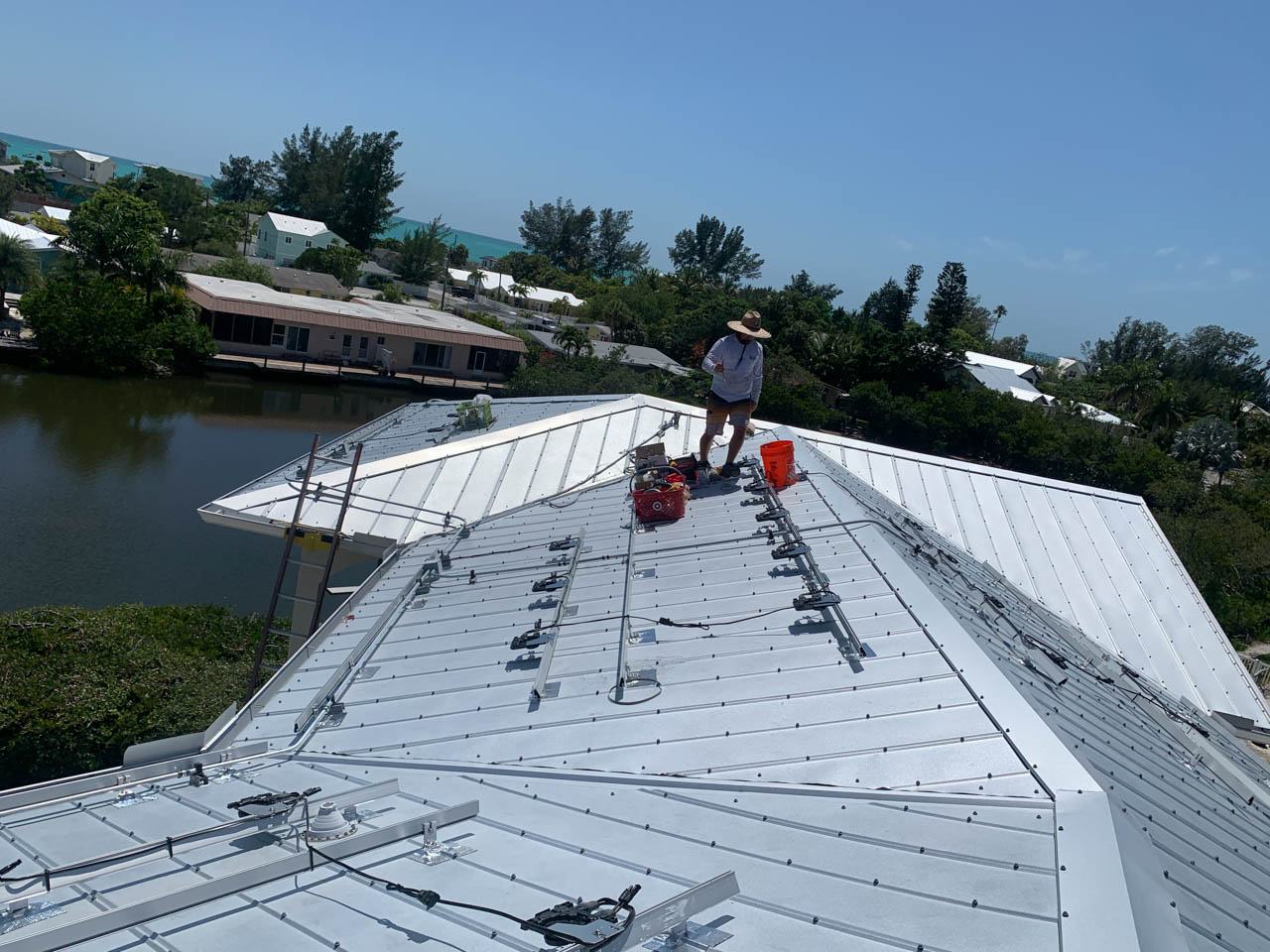 Racks and Inverters installed on a metal roof in Holmes Beach, FL