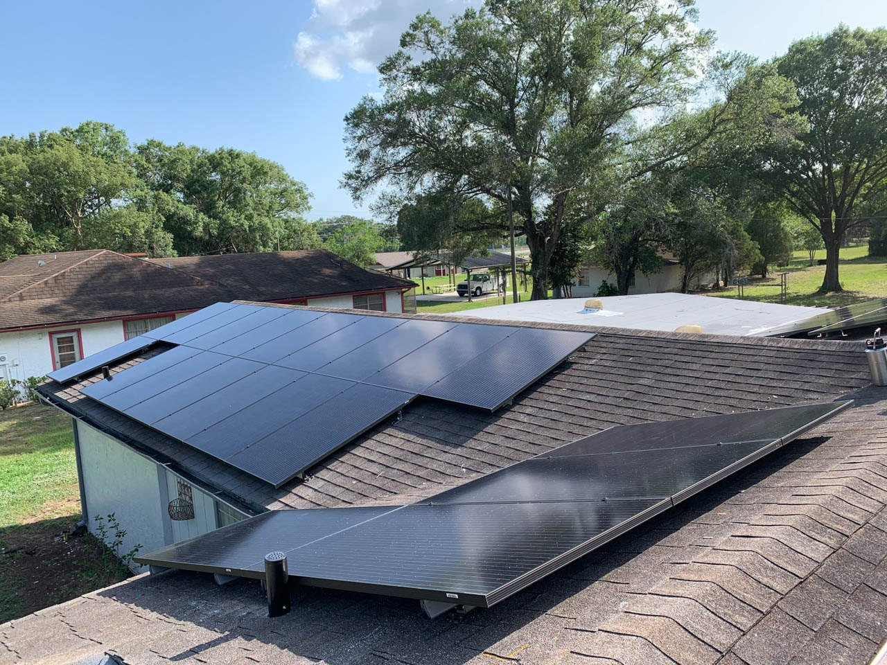 Roof view of a solar installation on a shingle roof in Thonotosassa, FL