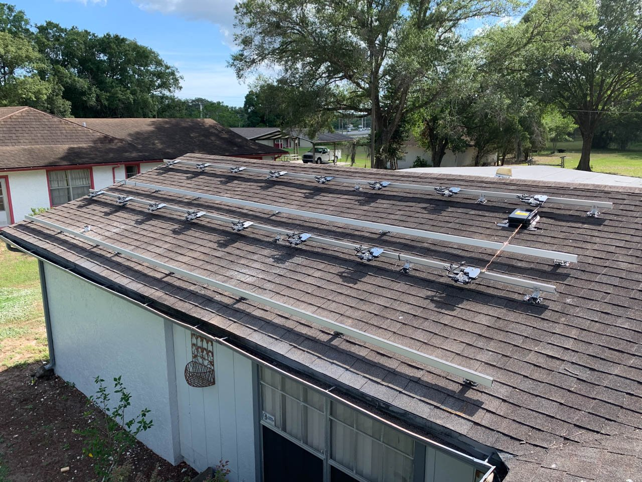 Solar rails and inverters installed on a shingle roof in Thonotosassa, FL