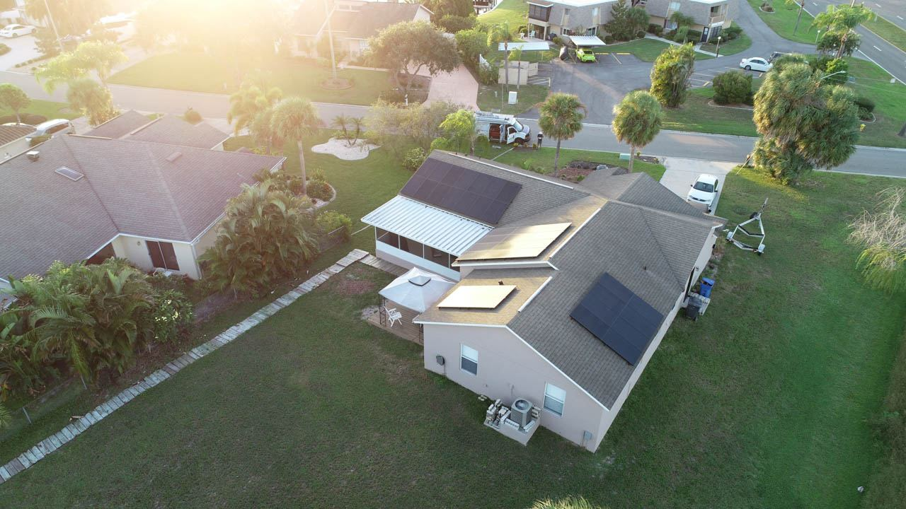 Drone view of solar system installed on a shingle roof in Apollo Beach, FL