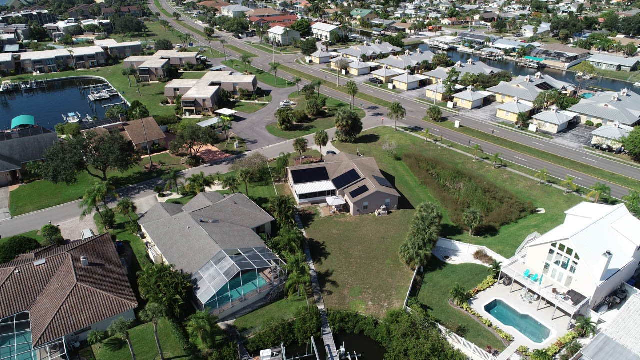 Aerial view of solar system installed on a shingle roof in Apollo Beach, FL