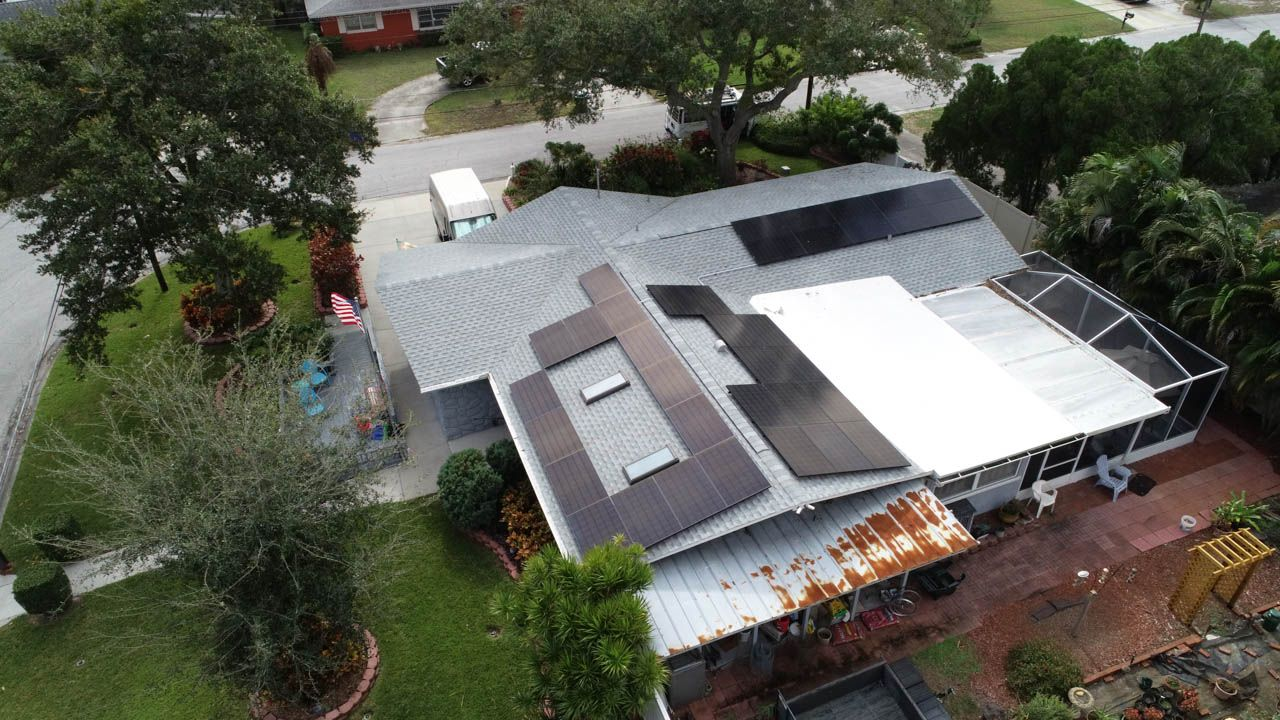 Drone view of solar installation on a shingle roof in Dunedin, FL