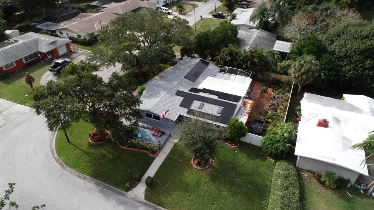 Aerial view of solar installation on a shingle roof in Dunedin, FL