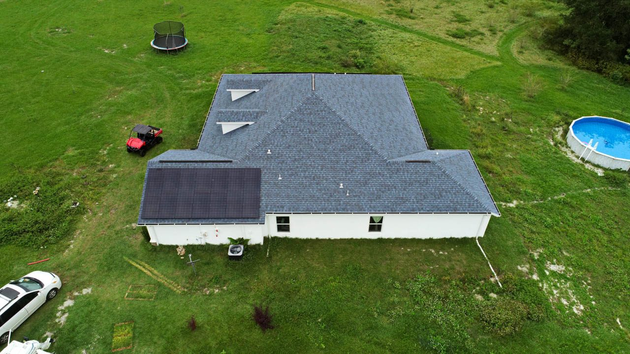 Drone view of a solar installation on a shingle roof in Dade City, FL