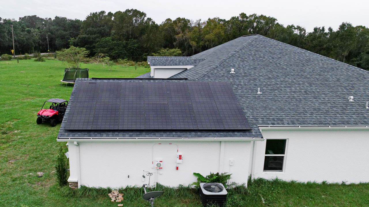 Roof view of a solar installation on a shingle roof in Dade City, FL